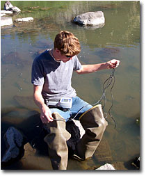 Kevin McAlerney preparing to take water temperature measurements of the Pit River.
