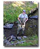 Kevin McAlerney conducting watershed monitoring in Joseph Creek.