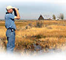 Todd Sloat scans for wildlife at the Ash Creek Wildlife Refuge.